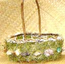Straw easter basket supply dealer distributes holiday baskets in oval shape with seashell decor and dried grass